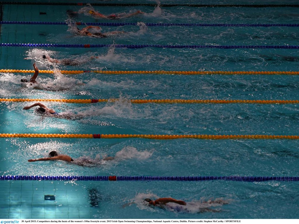 30 April 2015; Competitors during the heats of the women's 100m freestyle event. 2015 Irish Open Swimming Championships, National Aquatic Centre, Dublin. Picture credit: Stephen McCarthy / SPORTSFILE
