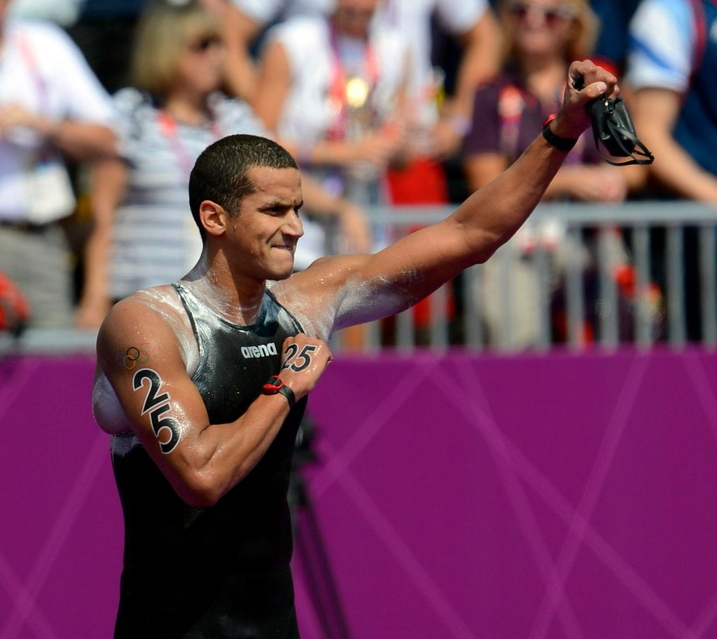 Aug 10, 2012; London, United Kingdom; Tunisia swimmer Oussama Mellouli celebrates after winning the men's open water 10km swim during the London 2012 Olympic Games at Hyde Park. Mandatory Credit: Andrew P. Scott-USA TODAY Sports