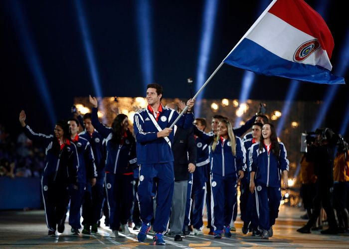 Jul 10, 2015; Toronto, Ontario, Canada; Paraguay flag bearer Benjamin Hockin leads the delegation in the parade of nations during the opening ceremony for the 2015 Pan Am Games at Pan Am Ceremonies Venue. Mandatory Credit: Rob Schumacher-USA TODAY Sports