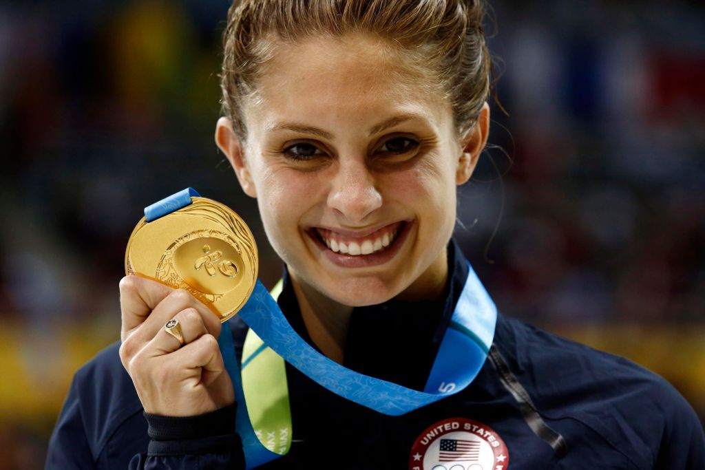Jul 17, 2015; Toronto, Ontario, CAN; Katie Meili of the United States poses with her gold medal after the women's 100m breaststroke final the 2015 Pan Am Games at Pan Am Aquatics UTS Centre and Field House. Mandatory Credit: Rob Schumacher-USA TODAY Sports