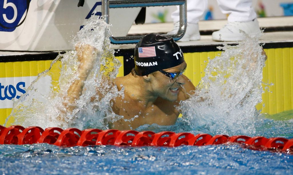 Jul 17, 2015; Toronto, Ontario, CAN; Nicholas Thoman of the United States celebrates after winning the men's 100m backstroke final the 2015 Pan Am Games at Pan Am Aquatics UTS Centre and Field House. Mandatory Credit: Rob Schumacher-USA TODAY Sports