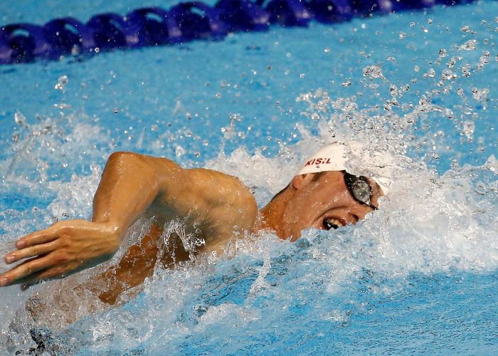 Jul 15, 2015; Toronto, Ontario, CAN; Yuri Kisil of Canada competes in the men's 4x200 freestyle relay preliminary heat during the 2015 Pan Am Games at Pan Am Aquatics UTS Centre and Field House. Mandatory Credit: Rob Schumacher-USA TODAY Sports
