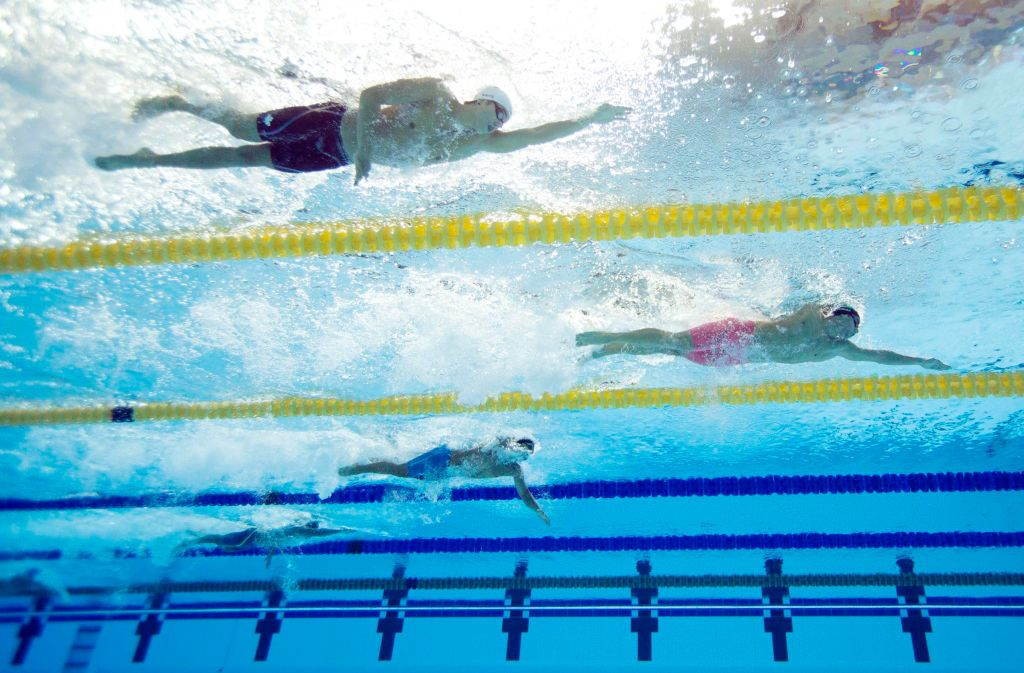 Jul 18, 2015; Toronto, Ontario, CAN; Thiago Pereira of Brazil (right) leads Evan White of Canada (top) in the men's swimming 200m individual medley preliminary heats during the 2015 Pan Am Games at Pan Am Aquatics UTS Centre and Field House. Mandatory Credit: Erich Schlegel-USA TODAY Sports
