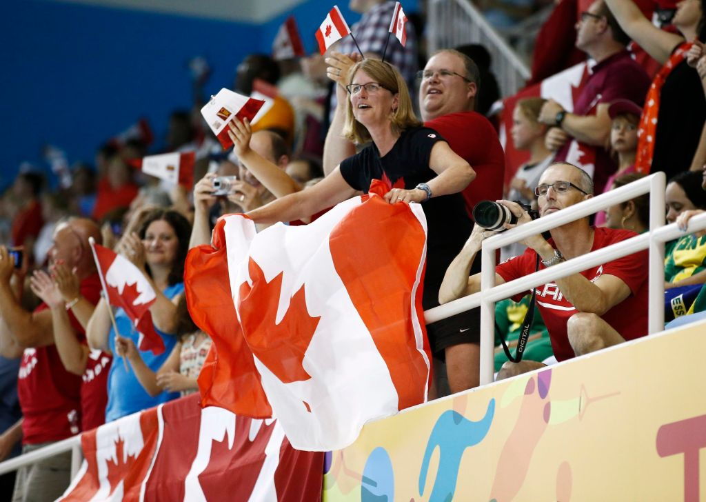 Jul 17, 2015; Toronto, Ontario, CAN; Canada fans wave flags from the stands during the women's 400m freestyle final the 2015 Pan Am Games at Pan Am Aquatics UTS Centre and Field House. Mandatory Credit: Rob Schumacher-USA TODAY Sports