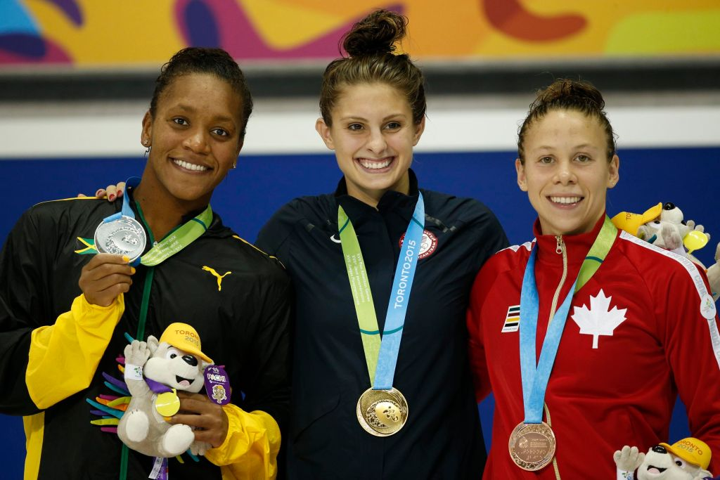 Jul 17, 2015; Toronto, Ontario, CAN; Alia Atkinson of Jamaica (left) , Katie Meili of the United States (middle) and Rachel Nicol of Canada (right) on the podium after the women's 100m breaststroke final the 2015 Pan Am Games at Pan Am Aquatics UTS Centre and Field House. Mandatory Credit: Erich Schlegel-USA TODAY Sports
