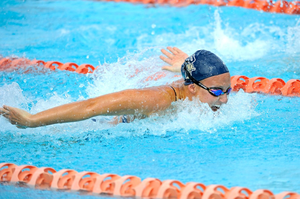 31 January 2015: FIU's Valerie Inghels competes in the 100 yard butterfly as the FIU Golden Panthers competed against the University of Miami at the University Center Swimming Pool in Coral Gables, Florida.
