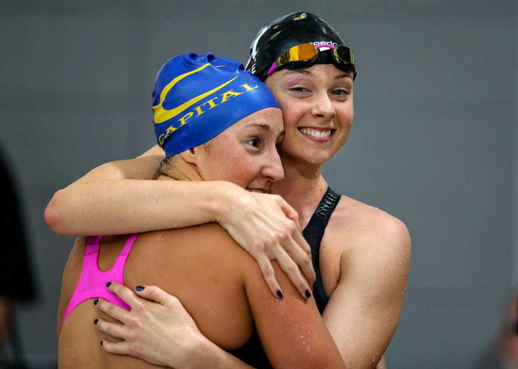 Lauren Boyle (R) and Emma Robinson embrace after qualifying for the Rio Olympics in the 800m freestyle during the New Zealand Open Swimming Championships, Owen G Glenn National Aquatic Centre, Auckland, New Zealand. Monday 28 March 2016 Photo: Simon Watts / www.bwmedia.co.nz