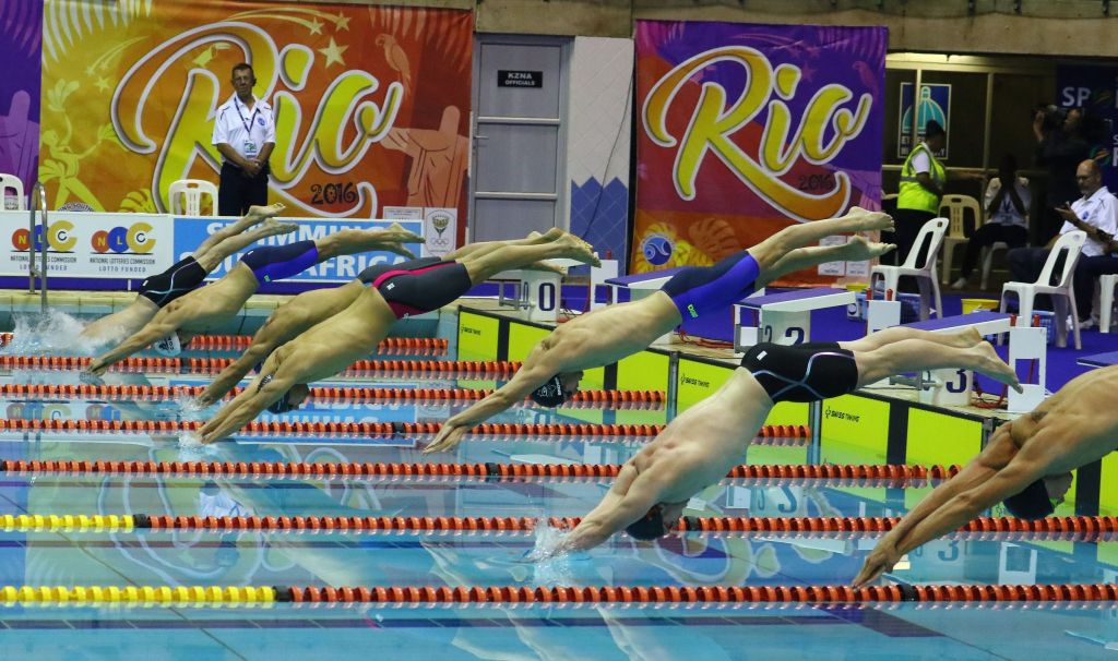DURBAN, SOUTH AFRICA - APRIL 13: Swimmers start for the mens 100m freestyle semi final during the finals session on day 4 of the SA National Aquatic Championships and Olympic Trials on April 13 , 2016 at the Kings Park Aquatic Center pool in Durban, South Africa. Photo Credit / Anesh Debiky/Swim SA