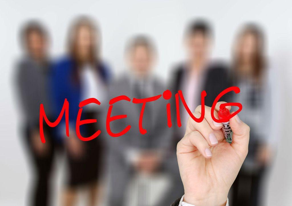 meeting-hand-blurry-people