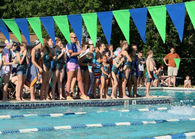 coach-and-swimmers