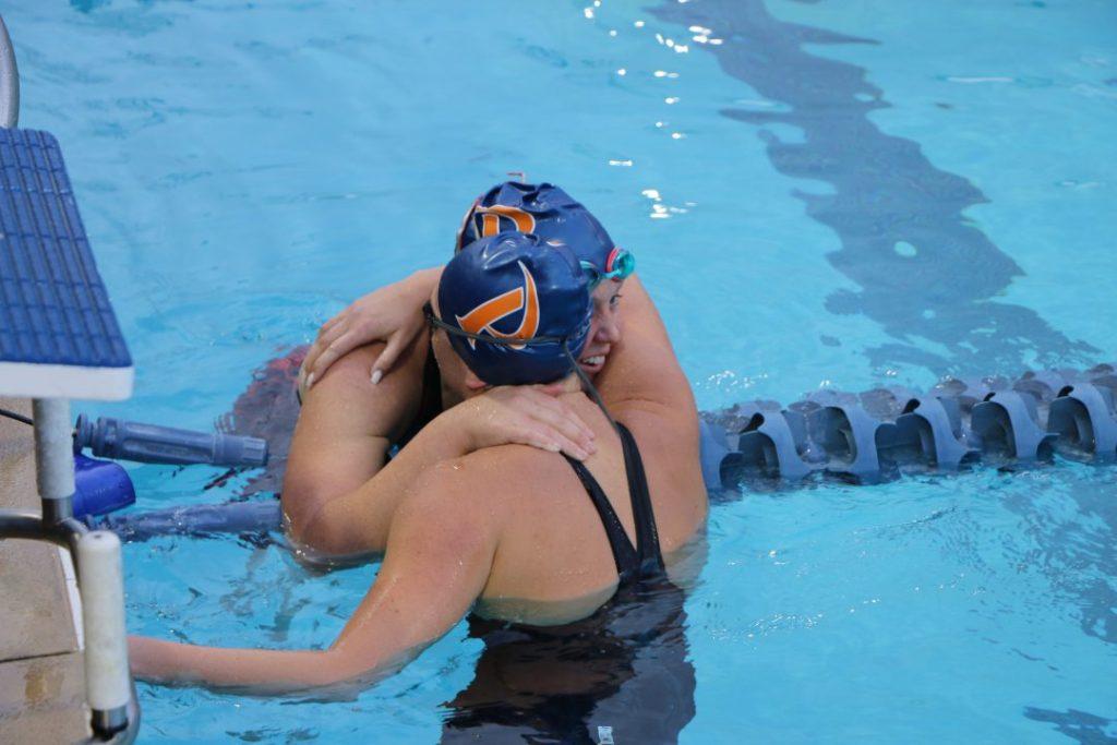 teammates-swim-meet-championship-post-race-hug-