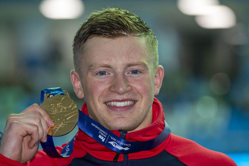 Adam Peaty of Great Britain poses with his Gold medal after winning in the men's 100m Breaststroke Final during the Swimming events at the Gwangju 2019 FINA World Championships, Gwangju, South Korea, 22 July 2019.