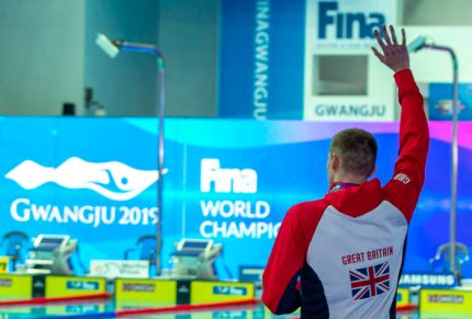 Third placed Duncan Scott of Great Britain is being celebrated by other swimmers, coaches and most of the crowd on his way out after refusing to pose with winner Yang Sun of China (not pictured) during the medal ceremony for the men's 200m Freestyle Final during the Swimming events at the Gwangju 2019 FINA World Championships, Gwangju, South Korea, 23 July 2019.