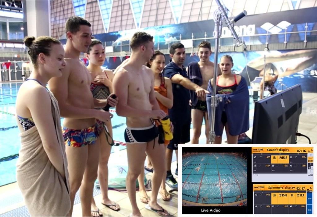 senswim-swimmers-looking-at-data-analytics-screens