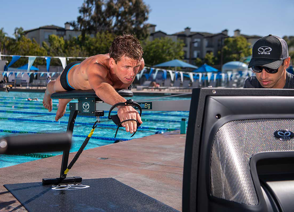 vasa-trainer-on-pool-deck-helps-coach-monitor-form