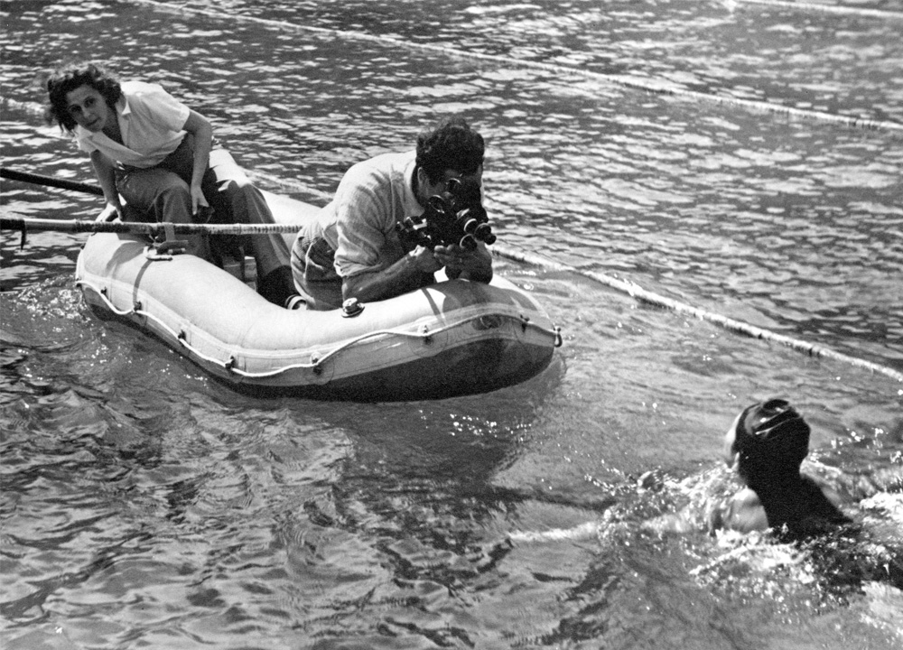 Swimming World January 2021 - Who Shot The Swimmers - The History of Swimming Through The Eyes of Photojournalists - Reifenstahl and Ertl filming in life raft
