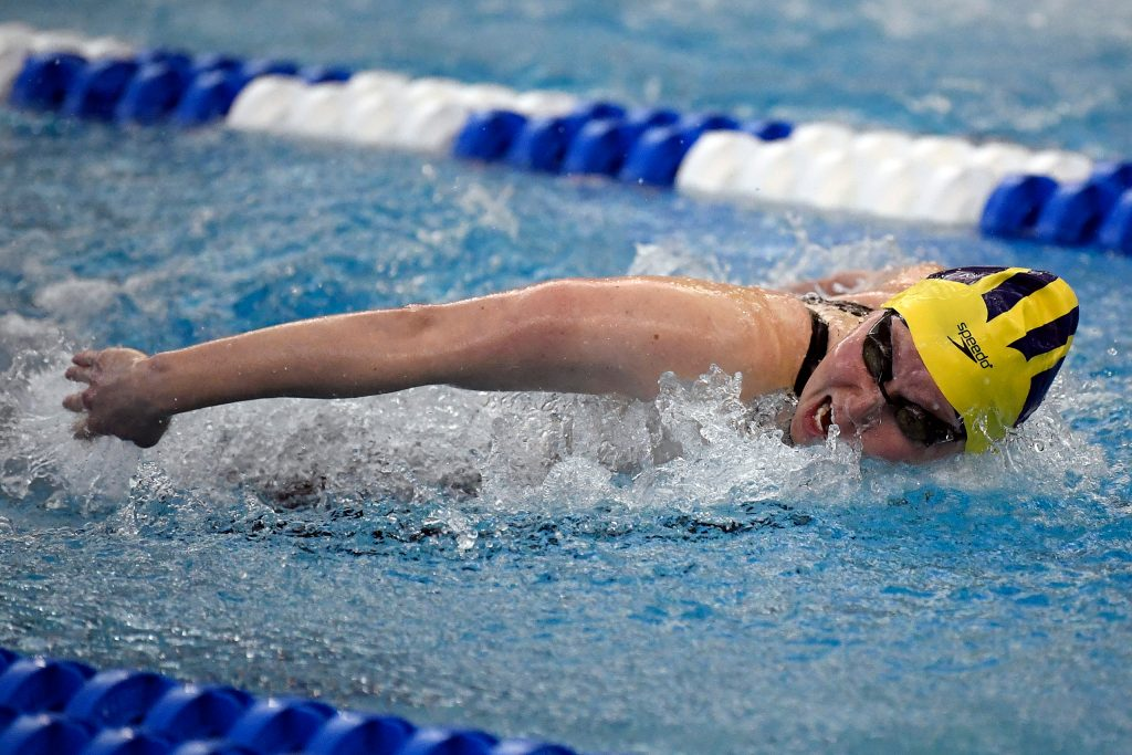 GREENSBORO, NORTH CAROLINA - MARCH 20: Olivia Carter of the Michigan Wolverines swims to victory in the 200 Yard Butterfly during the Division I Women's Swimming & Diving Championships held at the Greensboro Aquatic Center on March 20, 2021 in Greensboro, North Carolina. (Photo by Mike Comer/NCAA Photos via Getty Images)