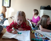 Grandchildren paint pillowcases before Christmas dinner