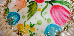 cake decorated with flowers painted on fondant