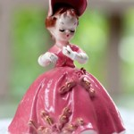 Figurine made in Japan by Arnat and titled Cherchez La Femm