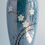 Blue, iridescent vase with enameled blossoms