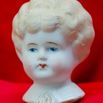 Blonde, Parian doll head with gilding, Victorian style