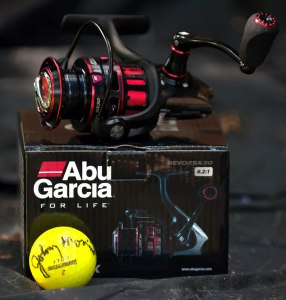 Volunteer goodie of a ABU Garcia reel and an autographed ball by Johnny Morris from the Legends of Golf dinner for tournament volunteers