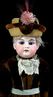 antique shoulder head doll with a bisque head