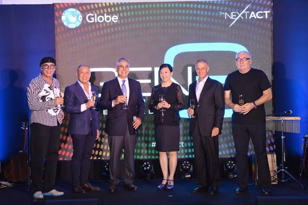 Leading a toast to open the new Globe Gen3 Store in Greenbelt were Ayala Corporation and Globe Chairman Jaime Augusto Zobel de Ayala (3rd from left) together with Singtel Group CEO Ms. Chua Sock Koong (3rd from right), Singtel Chairman Simon Israel (2nd from right), Head of Stores and Retail Transformation Management Joe Caliro (Leftmost), Globe President and CEO Ernest Cu (2nd to the left) and GEN3 Store designer and Founder and CEO of Eight, Inc. Tim Kobe (rightmost)