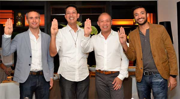 Globe President and CEO Ernest Cu (2nd from right) and De La Salle-College of Saint Benilde President Br. Dennis Magbanua FSC (2nd from left) flash the Benilde sign during the partnership agreement signing between Globe Telecom and De La Salle-College of Saint Benilde, enabling the school access to the telco's Brightspace Learning Management System. Joining them are D2L Senior Channel Sales Manager David O'Hagan (leftmost) and Globe Head of Sales Engagement for Globe Education Solutions Bobby Khan (rightmost).