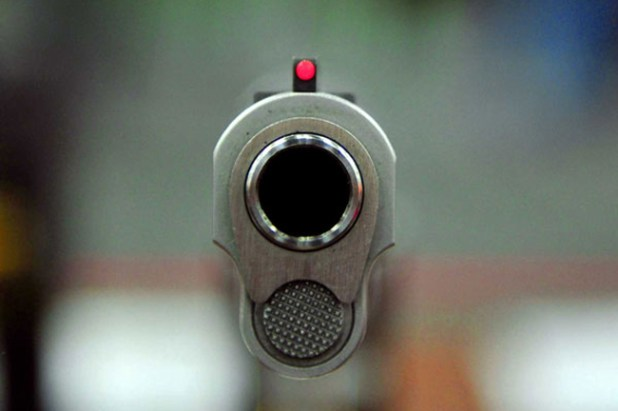 1527585910-gun-shooting-L