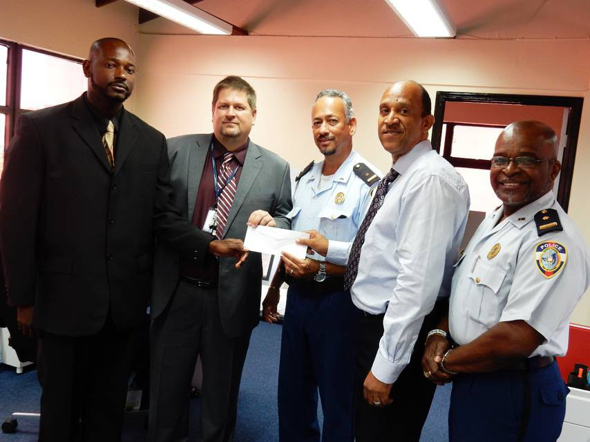 From L-R: P3 members; Gerard Lake and Michael Kanaby from the American University, Chief Inspector Benjamin Gout, Eric Ellis of Nagico Insurances & Chairman of P3 and Police Spokesman; Chief Inspector Ricardo Henson pose for a photo during the presentation yesterday at the Dispatch Center.