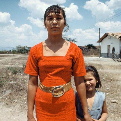 Woman in Red Dress with Sister, Honduras, 1994 ©Ben Marcin