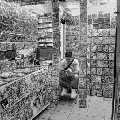 Mercado Ignacio Ramirez ©Owen Murphy The young seller of bootleg DVDs and CDs seemed lost in a haze of shiny packages, waiting and hoping for a sale or two.
