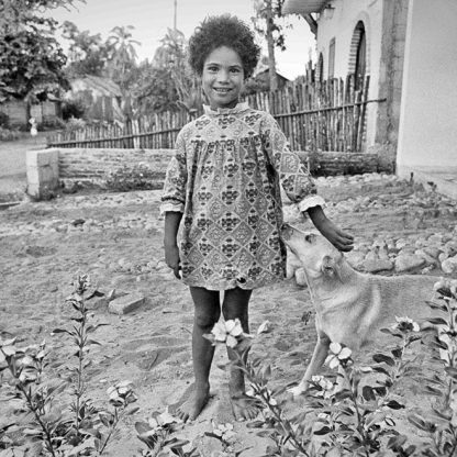 Michell y perro ©Owen Murphy I was renting a house in San Blas on on west coast of Mexico, a little north of Puerto Vallarta. She was a neighbor's child who was very curious about the gringos living next door. She hadn't been taught yet to be fearful of strangers.