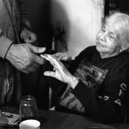 Ms. Lydia ©Owen Murphy I could barely understand a word she spoke. Fortunately her son was with me, a huge man who showed his tender love for a woman who knew how to survive on her own. On this day, he was bringing her a package of Bugler tobacco for her to smoke in her pipe.