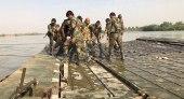 قوات إيرانية تستعد لبناء جسر حربي على نهر الفرات في سوريا