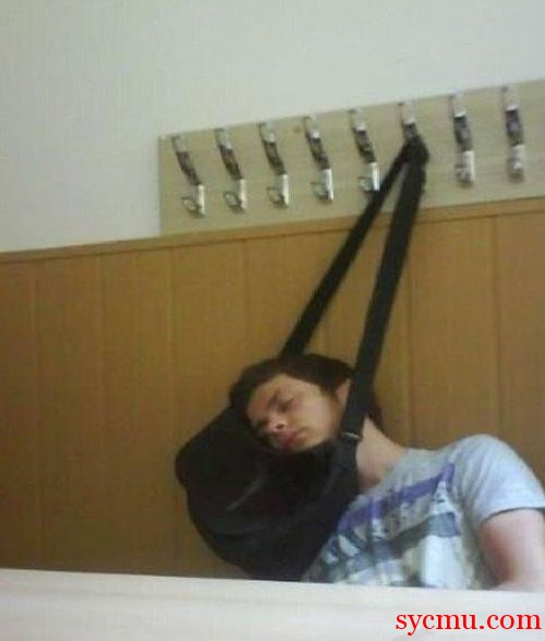 Boy sleeping with his head resting on a hanging bag