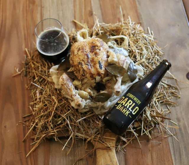Chicken cooked in dark ale and hay