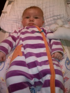 Looking serious in her purple stripes