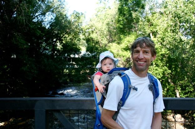 Sydney in backpack next to Boulder Creek