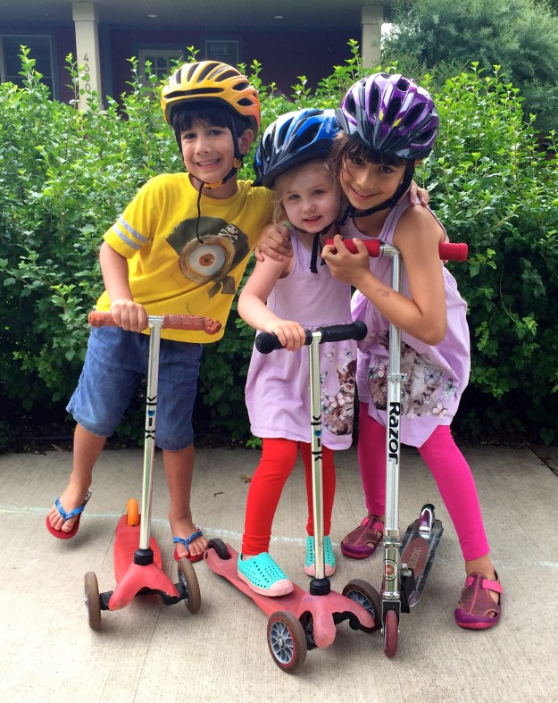 Liam, Sydney, and Lila on scooters