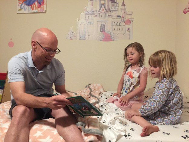 Michael Fleetwood reading to Evie and Sydney during sleepover