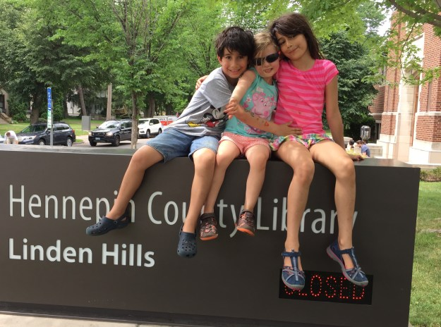 The kids outside the library.