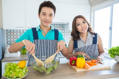 couple making salad