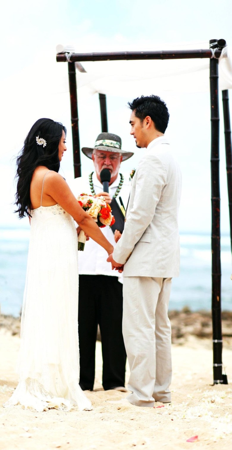 Beach Wedding Vows featured by top US life and style blogger Sylvie in the Sky; Image of a couple on their wedding day.