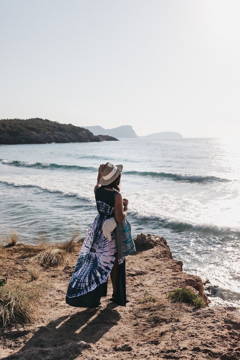 How to Manifest Anything You Want - 4 Steps by popular San Francisco lifestyle blog, Sylvie in the Sky: image of a woman standing on the beach and looking out over the ocean.
