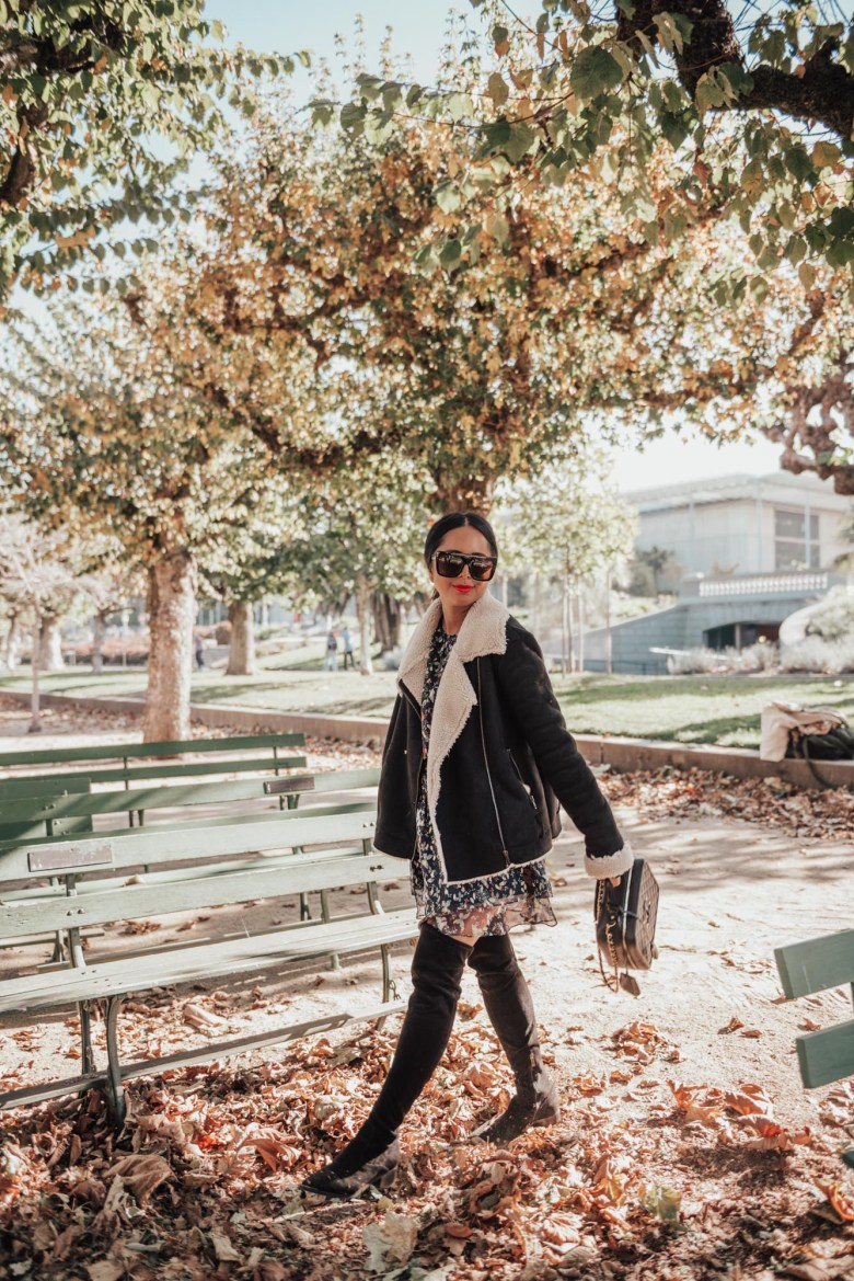 17 Best Over the Knee Tall Boots for $100+ by popular San Francisco fashion blog, Sylvie in the Sky: image of a woman outside wearing over the knee tall boots.