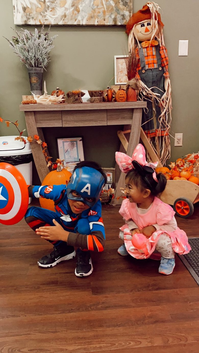 At Home Halloween by popular San Francisco motherhood blog, Sylvie in the Sky: image of a young boy dressed up as Captain America and a young girl dressed up as Minnie Mouse.
