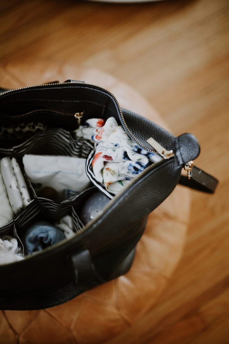 Biodegradable Baby Wipes by popular San Francisco motherhood blog, Sylvie in the Sky: image of a black diaper bag filled with baby supplies.